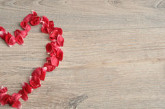A heart made out of red rose petals Stock Photo