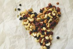 Trail Mix Heart. Heart made out of trail mix on white wrinkled paper background. Horizontal. Healthy eating concept Royalty Free Stock Photo