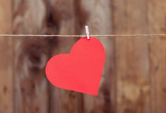 Heart made of paper hanging on a rope Royalty Free Stock Images