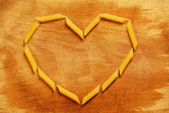 Heart made with pastas. Heart made with penne rigate Italian pastas Stock Photography