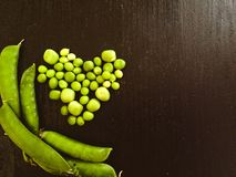 Heart made with peas and several pods Stock Photo