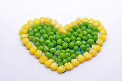 Heart made from peas and sweetcorn Stock Image
