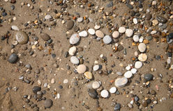 Heart made with pebbles on the beach royalty free stock image