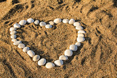 Heart made with pebbles on the beach Royalty Free Stock Photo