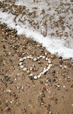 Heart made with pebbles on the beach, vertical Stock Photography