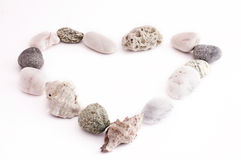 Heart made of pebbles and shells. Isolated on withe background Royalty Free Stock Photo