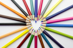 Heart made of pencils. A heart shape made of coloured pencils on white background Royalty Free Stock Photography