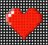 Heart made from plastic construction blocks Stock Images