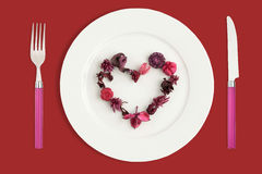 Heart made of potpourri. Fork and knife with clipping paths Stock Photos