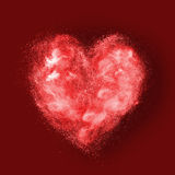 Heart made of powder explosion on red Stock Photos
