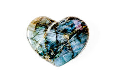 Heart made of precious stone in front of white background Royalty Free Stock Photo