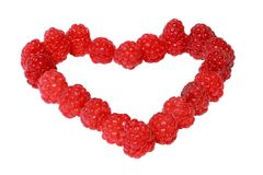 Heart made of raspberries Stock Photography