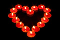 A heart made with red candles stock photography