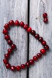 Heart made of red cherries. Stock Photography