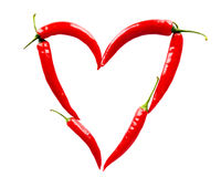 Heart made of red chili peppers on white Stock Image