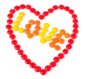 Heart made of red colored sweets round Royalty Free Stock Photo