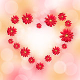 Heart made of red daisy gerbera flowers. Blurred pastel bokeh background Stock Images