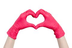Heart made of red medical gloves isolated on white background. Heart made of red medical gloves, Healthy lifestyle, benefits of vitamins, vaccination, afraid of royalty free stock photos