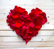 Heart made of red petals Royalty Free Stock Photography