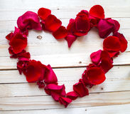 Heart made of red petals Stock Photography