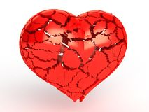 Heart made of red plastic, broken into pieces �2 Royalty Free Stock Photography