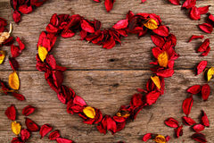 Heart made from red potpourri flower petals - Series 3 Royalty Free Stock Photos