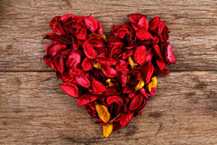Heart made from red potpourri flower petals Stock Photos