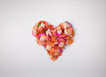 Heart made from red rose petals, on white background. Composition for themes like love, valentine`s day, holidays. High resolution. Photo Royalty Free Stock Photo