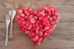 Heart made of red roses in wooden background. To represent personal feelings stock photography