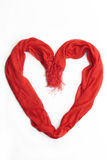 Heart made of a red scarf. Isolated on white Stock Image