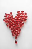 Heart made from red soft pills. On a white background Stock Photo