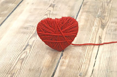 Heart made of red wool yarn Stock Photo