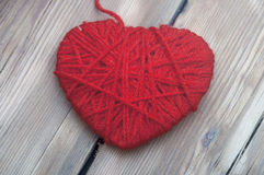 Heart made of red wool yarn Royalty Free Stock Images
