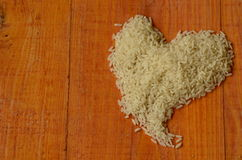 The heart made from rice. Rice, love, heart, reis, arroz, riso, riz, рис, liebe, amor, amore, amour, любо́вь Royalty Free Stock Images