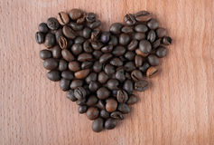 Heart made of roasted coffee beans Royalty Free Stock Photography