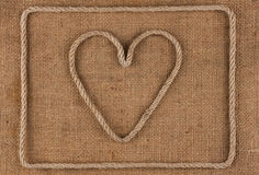 Heart made of rope on burlap Royalty Free Stock Photos