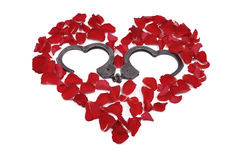 Heart made of roses with handcuffs inside Stock Images