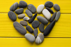 Heart made of sea pebbles stock photos