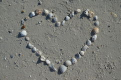 Heart made from seashells. On the beach Stock Photography