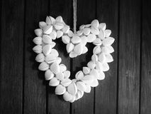 Heart made from shells hung on door Royalty Free Stock Photos