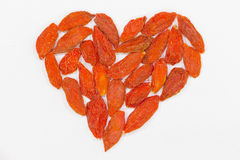 Heart made of small red wolf berries Stock Photos