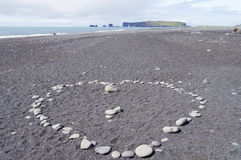 Heart made of small stones on sand, on the beach. Heart made of small stones on sand on the beach,Vik,Iceland stock image