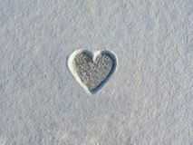 Heart made in snow in the winter stock image