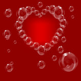 A heart made from soap bubbles on a red background Stock Images