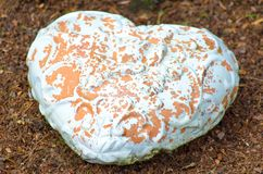 Heart made of  stone. Heart made ??of clay stone, the white color drops Stock Photo