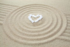 Heart made of stones. On sand stock photo