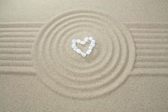 Heart made of stones. On sand stock image