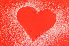 Heart made of sugar. On red background Royalty Free Stock Photography
