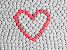 Heart made of tablets. Heart made of red pills on a background of white pills royalty free stock image