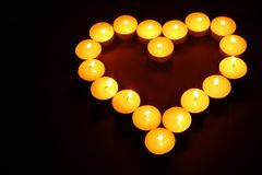 Heart made of tea lights. In dark high angle view Stock Photo
